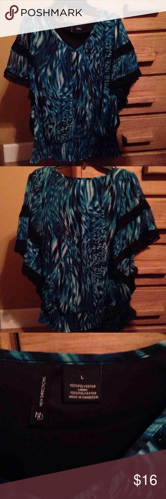 Vibrant color batwing top, size large New Directions top from Belk's. Worn gently, EUC. Beautiful colors with silver threads throughout. Crochet detail on each arm & smocked bottom. Size large.  100% Polyester Lining: 100% Polyester new directions Tops Blouses