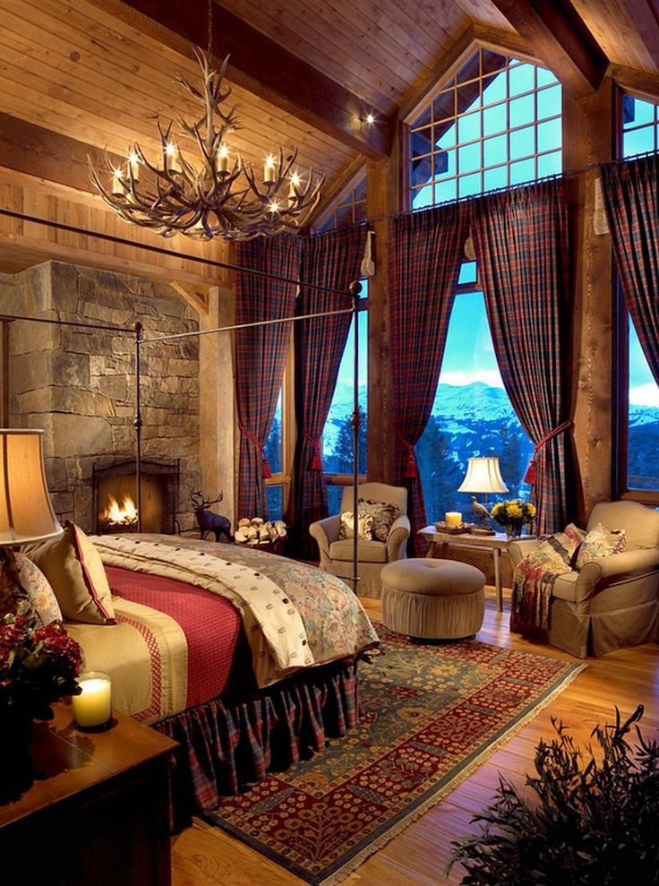 Grand Log Cabin Bedroom. Floor to ceiling windows and a fireplace ❤