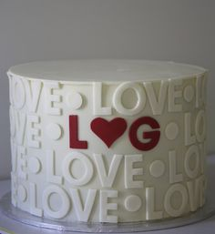 """Engagement Cake with Couple's Initials in Fondant Surrounded by """"LOVE."""" Honestly though, I've NEVER heard of an engagement cake...Do people actually do this? Maybe for an engagement party..."""