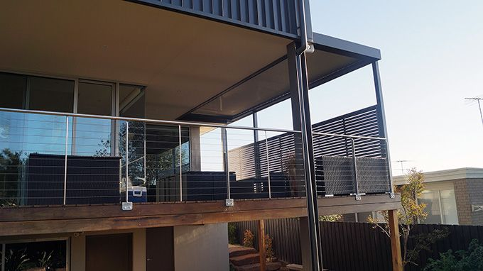 This Louver Roof  Deck to side of dwelling with colorbond screens built by Totally Outdoors in Doncaster