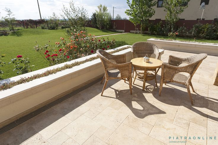 Flooring cladded with travertine Classic, French pattern. A terrace on a residential property in Prahova County, Romania.