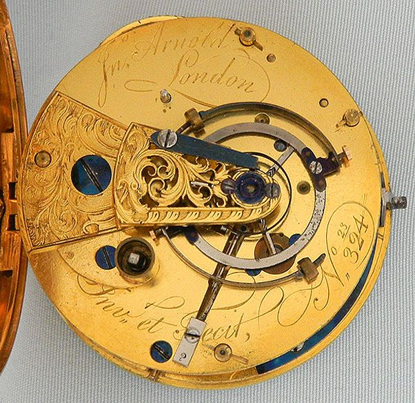 "John Arnold (1736 - 1799) was an English watchmaker and inventor. He was the first to design a watch that was both practical and accurate, and also brought the term ""Chronometer"" in to use in its modern sense, meaning a precision timekeeper. His technical advances enabled the quantity production of Marine Chronometers for use on board ships from around 1782. The basic design of these, with a few modifications unchanged until the late twentieth century. With regard to his legacy one can say…"