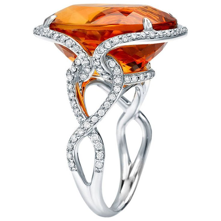 "*Tamir Striking Madeira Citrine And Diamond Ring, A very bright and ""sunny"" oval-shaped 16.40ct Madeira Citrine and 0.66ct diamond ring. Crafted in 18K white gold. Finger size 6.5. Can be sized to fit. Signed by Tamir."