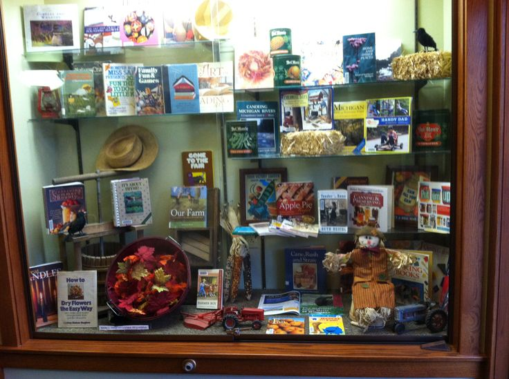 Fall Library Display ideas. We used a cider press, antique tractor toys, miniature hay bales, produce containers, straw hat, canning jars etc.