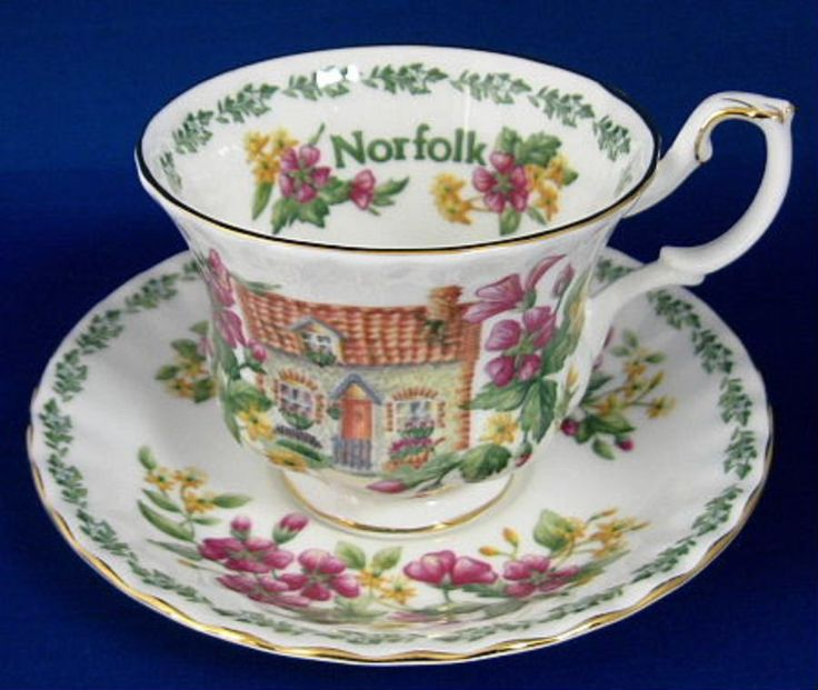 This is a Royal Albert china, England cup and saucer in the English Country Cottages series called Norfolk made IN England. The bone china cup is 3 inches high, the saucer is 5.5 in diameter and both