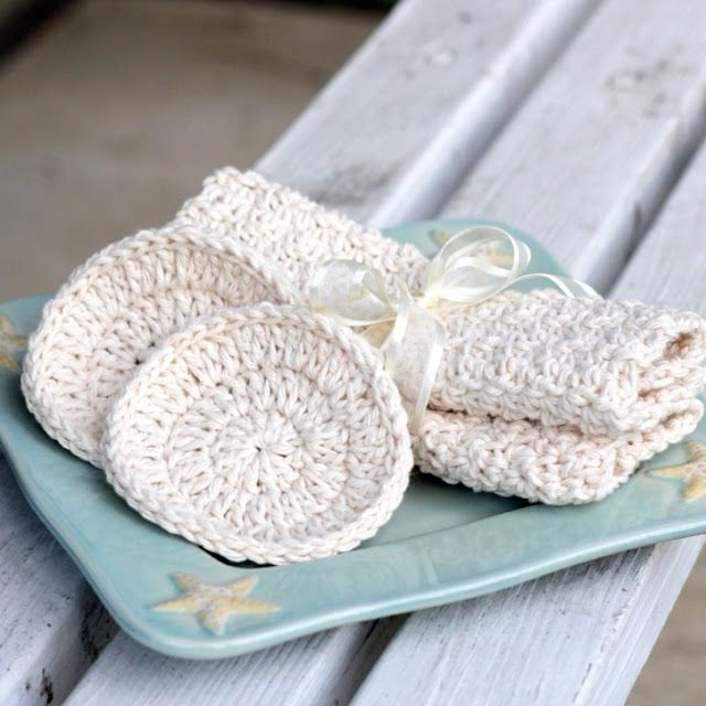 A set of cotton washcloths and facial scrubbers Crochet pattern included.