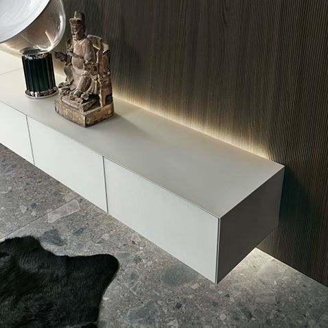 detail of the avorio mat lacquered glass suspended drawer, with a continuous perimetral aluminium profile