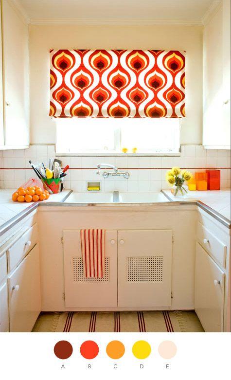 White & orange kitchen.