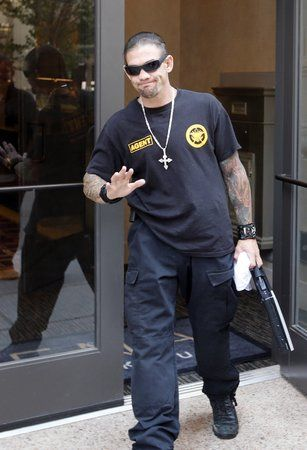 """Leland Chapman, a cast member of """"Dog The Bounty Hunter"""" waves to fans in front of the Ambassador Hotel. (May 7, 2013)"""