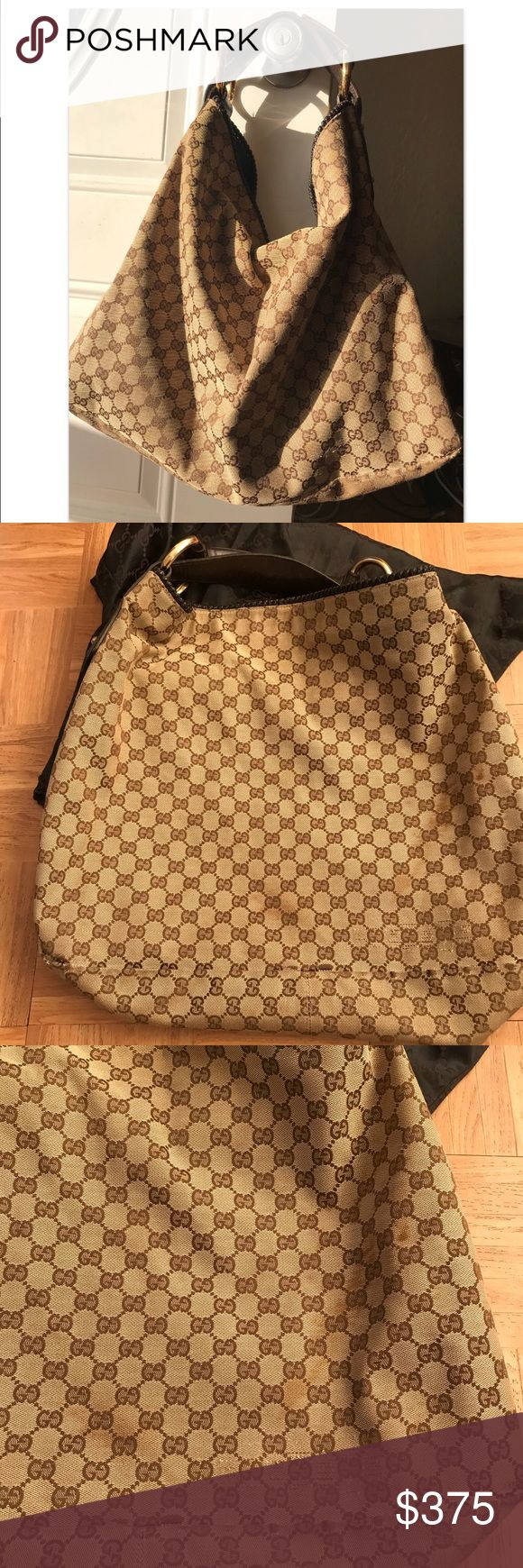 100% authentic large GUCCI hobo Large Gucci Hobo used but still beautiful. No stains or rips inside. Some wear as expected on bottom corners but nothing obvious. stain on one side but it blends in with the brown and it's not obvious unless you are actually looking for it. Hard to find bag, doesn't make anymore. Dust bag included. I have receipt but it faded over the years. You can see some words in certain angles. Gucci Bags Hobos