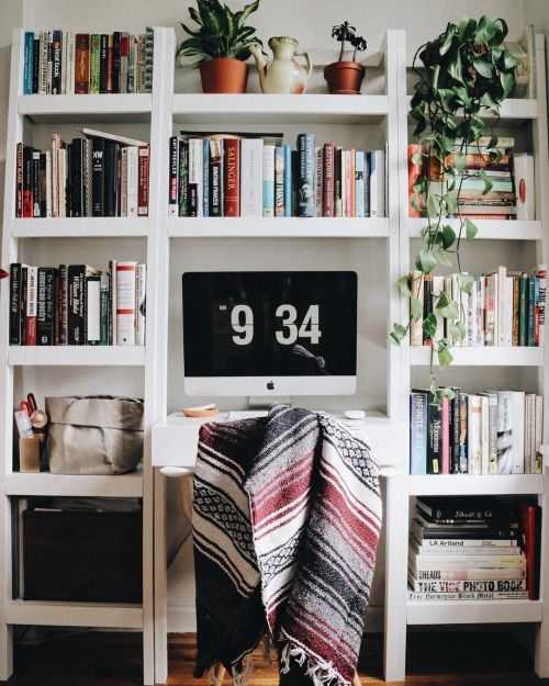 This is one of the most beautiful work spaces I ever seen. I LOVE this bookshelf :)