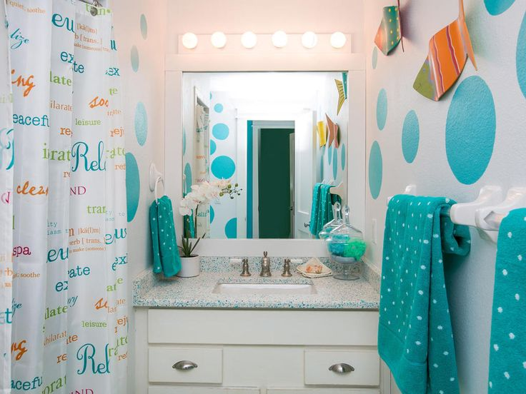 One of the four bathrooms at Limefish - The sea themed decorations and fun fish artwork means the beach will never be far from your mind in our coastal villa.