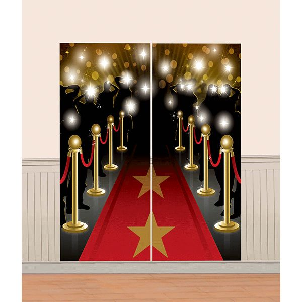 Set the scene for your Hollywood extravaganza party! The Hollywood Scene Setter Wall Decoration has everything you could want - a red carpet with gold stars, gold posts with red ribbon, and bright lig