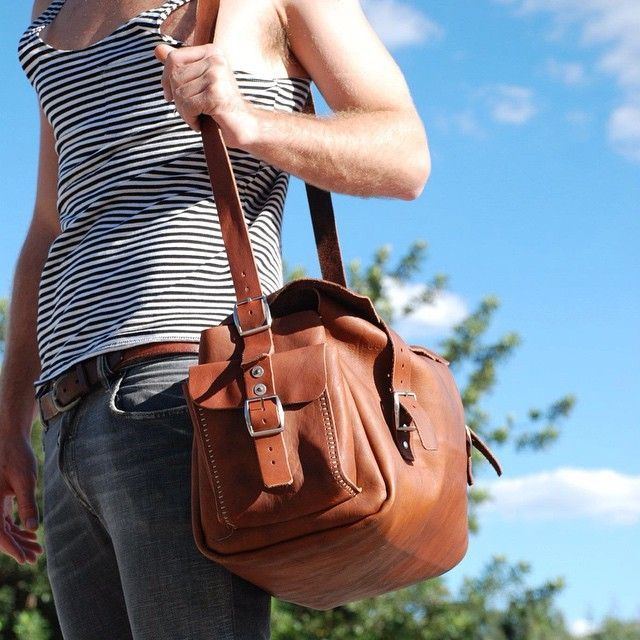 Red Oker leather travel bag on the move