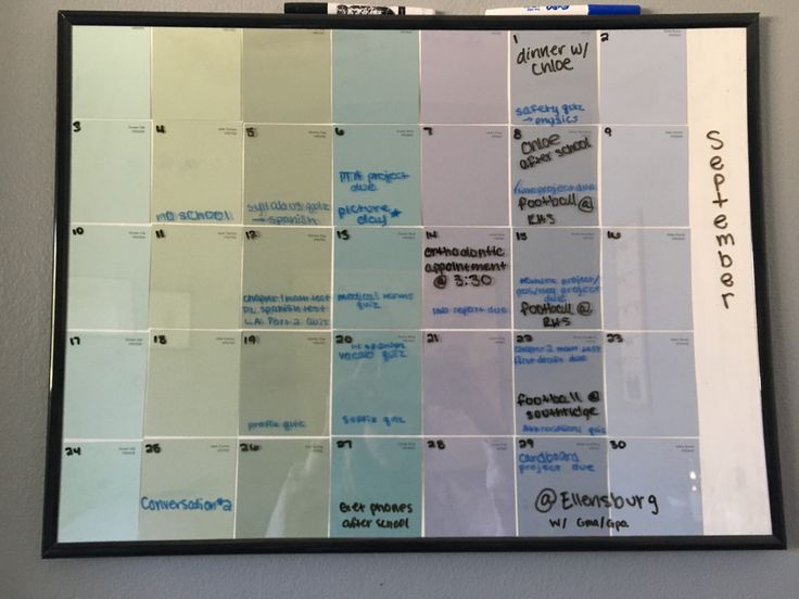 Paint sample wall hanging planner using a poster frame and white board markers