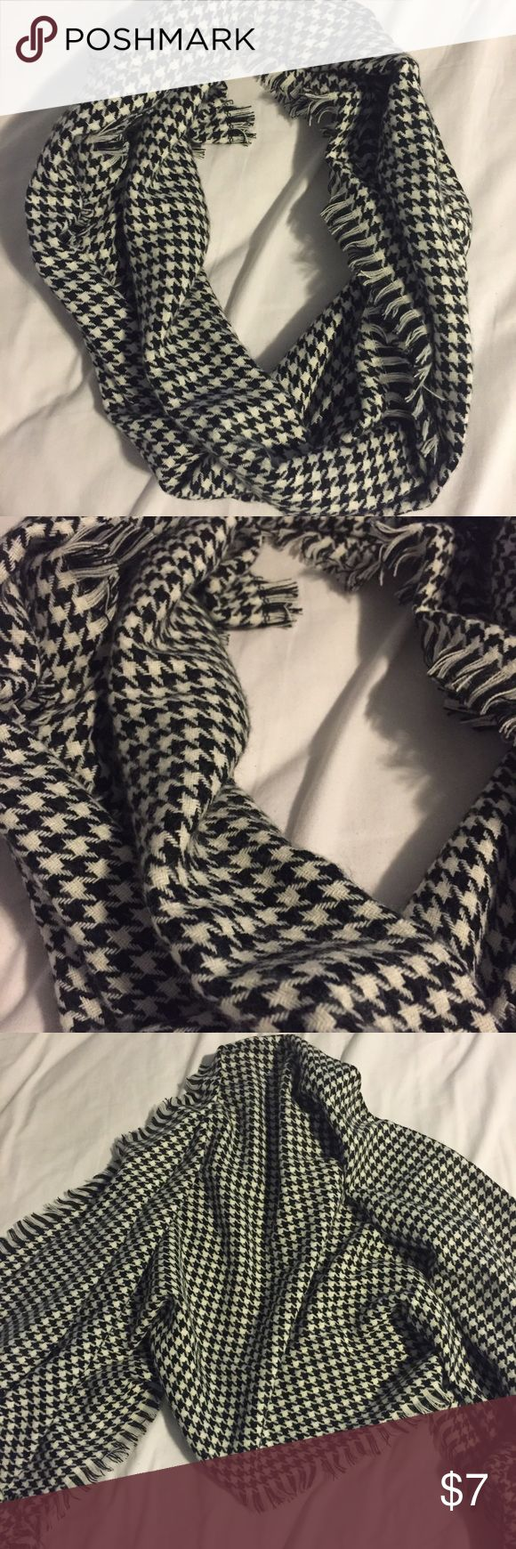 Black and White Scarf This is a black and white (checkered?) scarf! Never worn but doesn't have tags. This has been washed once and didn't bleed on to whites! It is very soft and a strong material that will keep you warm! Accessories Scarves & Wraps