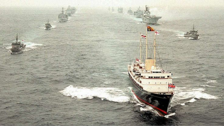 """The departing Royal Yacht Britannia, carrying the Prince of Wales and former governor Chris Patten, leads Royal Navy vessels in a ceremonial """"steam past"""" to the south of Hong Kong, on July 1, 1997. Pictures: Reuters; SCMP"""
