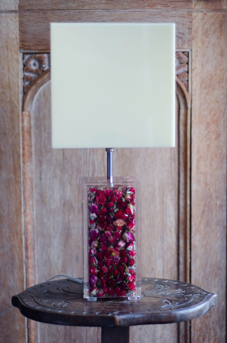Acrylic lamp filled with red rosebuds