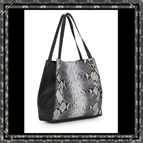 "Snake-Embossed Patent Tote from Saks Off 5th This is a roomy tote in multitonal snake-embossed patent. It features double top handles with a 10"" drop, top magnet snap closure and stud detail. Inside is lined and has a pouch, a zip pocket and two slip pockets. Tote measures 13""x13""x5"" and the inside pouch measures 12""x8""x1'. NWT. Saks Off 5th Bags Totes"