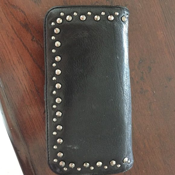 Banana Republic Studded Wallet Checkbook sized wallet with interior zipper pouch and many credit card slots. It has a few minor marks from use, but is in excellent condition overall.   Offers only through the offer feature!  Use the bundle feature to automatically receive my discount on bundles! Banana Republic Bags Wallets