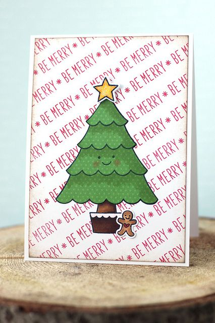 Lawn Fawn - Trim the Tree stamps and coordinating dies, Peace Joy Love stamps, Sweet Christmas _ the fabulous stamped background and cute added smiley face add to the charm of Elena's card