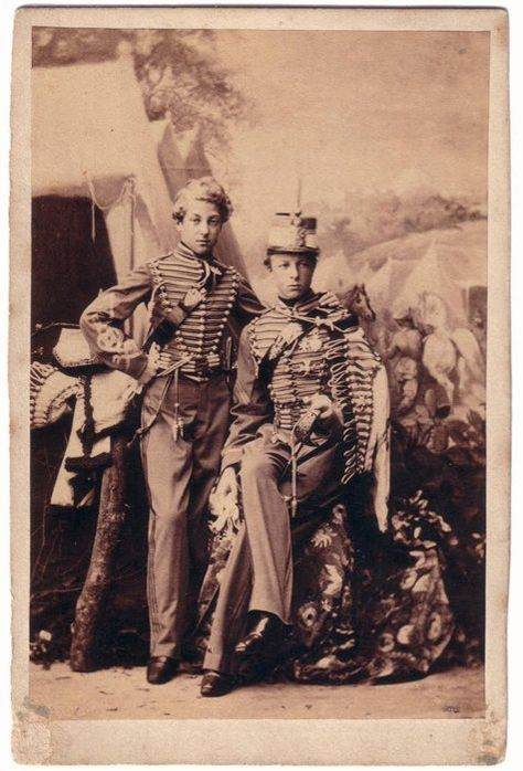 GAston and Ferdinand D`Orleans, . Gaston later became the Comte D`eu and Ferdinand, le Duc d Alencon.  A little over dressed perhaps.