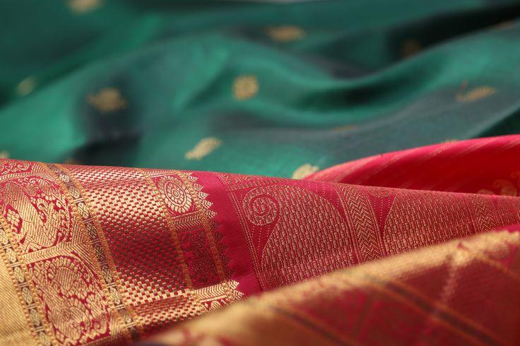This gorgeous teal green sari has a striking red korvai border, highlighting the beautiful drape of the silk #kanakavalli #kanjivaram #silk #sari #korvai #handloom #india