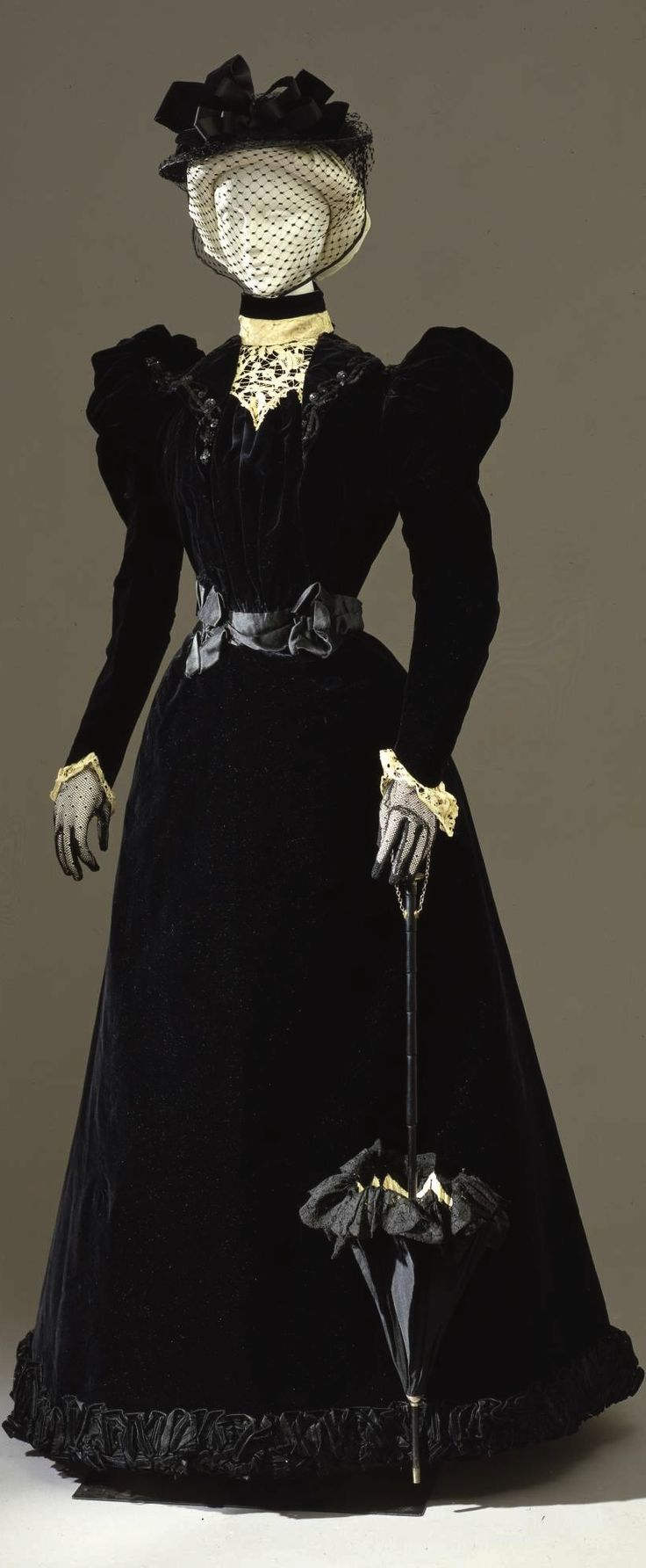 Black silk velvet walking dress in two parts (bodice and skirt), by Atelier Mrs. C. Donovan, New York, c. 1897-99, at the Pitti Palace Costume Gallery. Via Europeana Fashion.