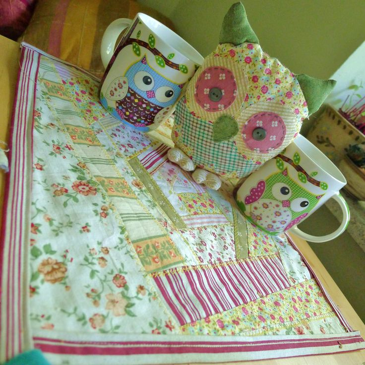 owl softie on a crazy quilted placemat