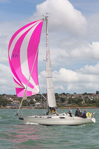 The Contessa 32 yacht 'Mary Rose Tudor' racing in the Solent during Cowes Week 2013.