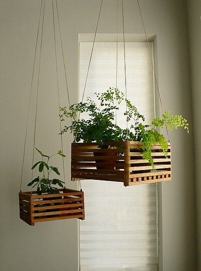 Hanging Planters Use simple wooden boxes and some wire to make adorable hanging planters.