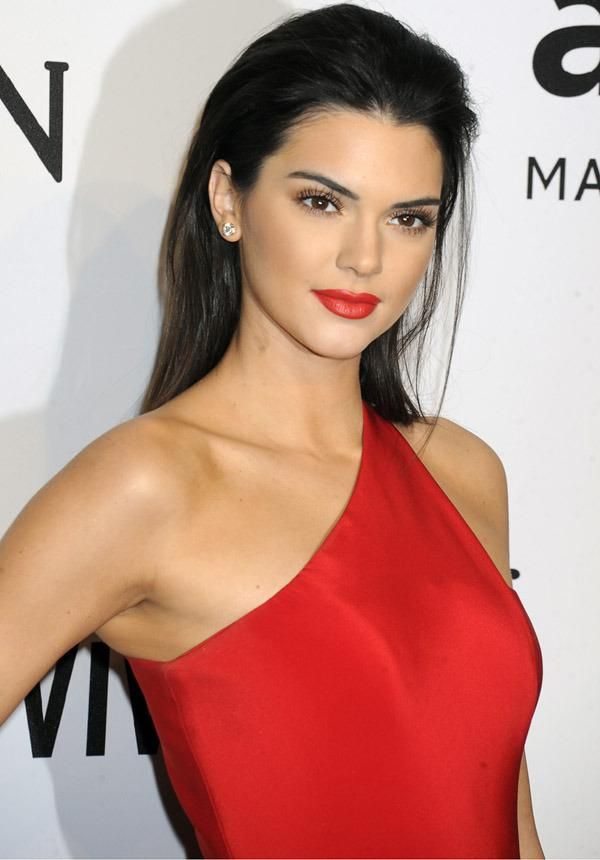 Kendall Jenner wear a bold satin red lip + matching one-shoulder dress and slicked-back hair