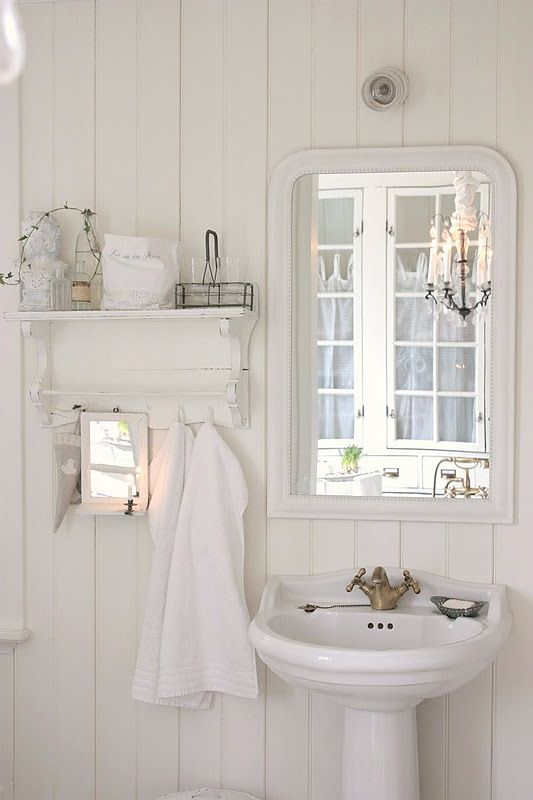 A pretty cottage bathroom. Love the little shelf.