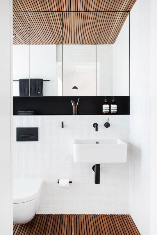 sunken shelf below mirror-cabinets - do the back areas in wood, and taps, cistern, etc below 'shelf' burried in the tiled wall