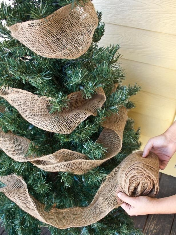 Just a simple burlap garland will spruce up any front porch Christmas tree: