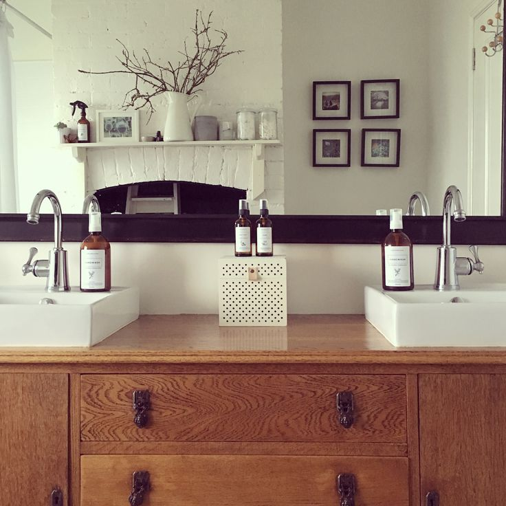 I found this gorgeous dresser and converted it to a double vanity. The bathroom was the original kitchen of our home, hence the brick fireplace! This is featuring my foaming hand soaps made from #organiccastile and my body and home mists using pure essential oils. Products can be purchased from etsy: https://www.etsy.com/au/shop/archimedesandMe   #homemade #handwash #amberbottle #allnatural #aromatherapy #countrystyle #bathroom #diy #essentialoils #dresser  #archimedesandme
