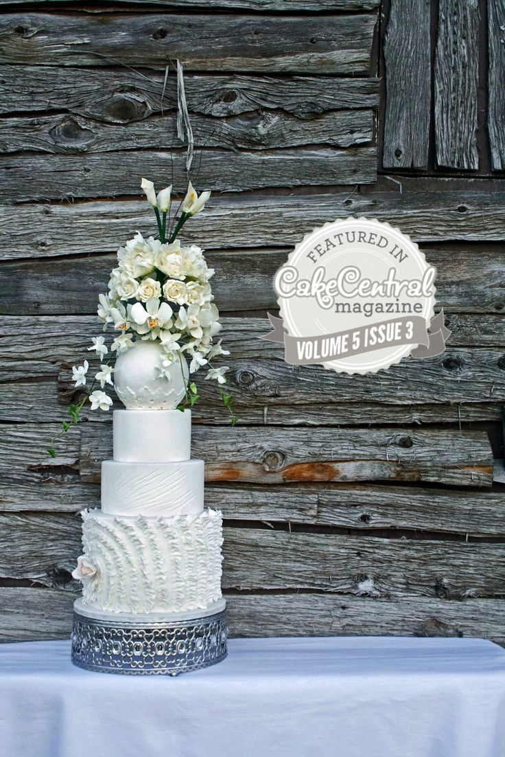 White wedding cake featured in CakeCentral Magazine.  Photo by Chelsea Delorme