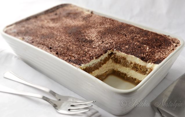 Easy Tiramisu without eggs :  1 cup whipping cream 1 cup Mascarpone cheese 2-3 Tbs sugar, to taste 1 tsp vanilla extract 1 Tbs amaretto or rum 2½ cups strong cold coffee about 7 oz (200 g) ladyfingers (savoiardi) cocoa, for dusting