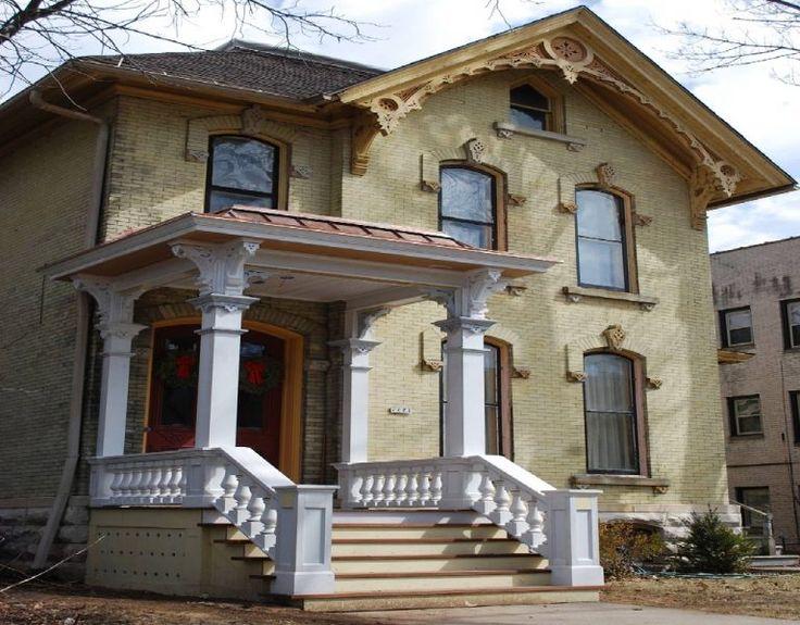 Yellow brick Italianate needs paint