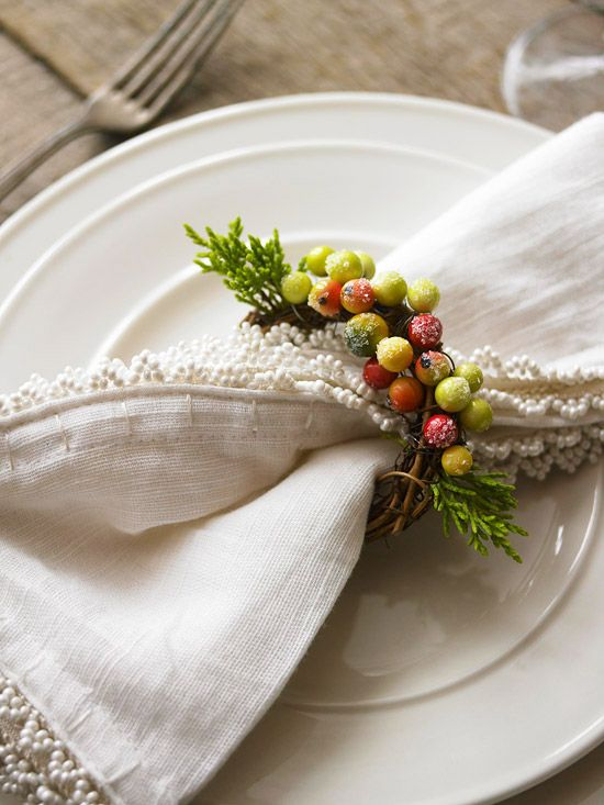 Wrap napkins in a frosty wreath! More holiday #decorating ideas: http://www.bhg.com/decorating/do-it-yourself/accents/nature-crafts-for-winter-table/