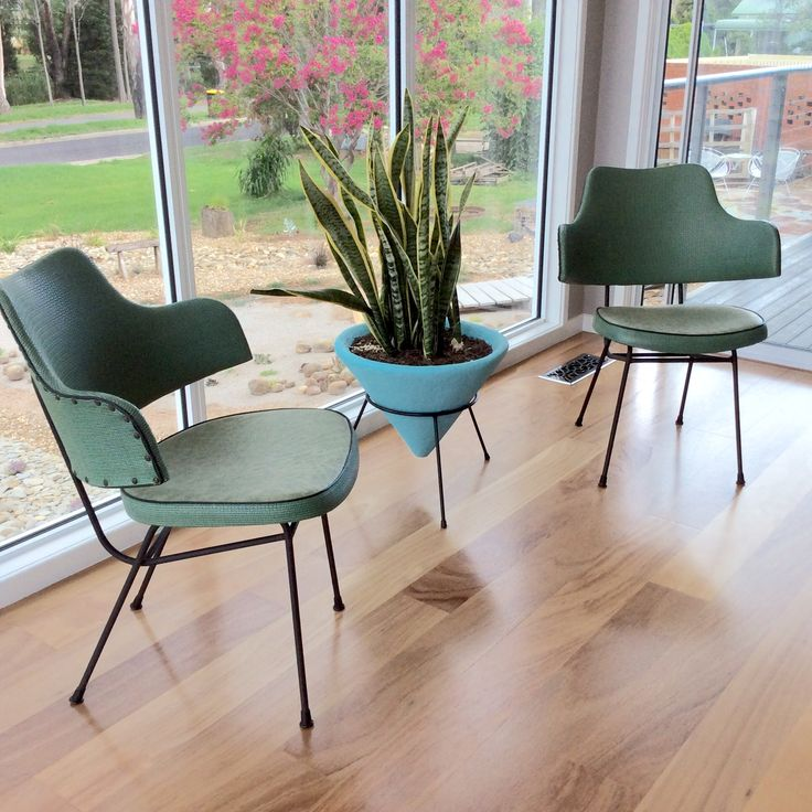 Mid century steel rod arm chairs. I believe by Grant Featherston