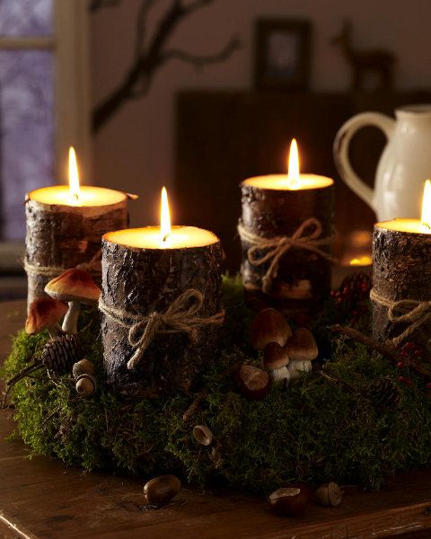 I like the mini log candle holders with sisal. Could be an every day look without the greenery and mushrooms.