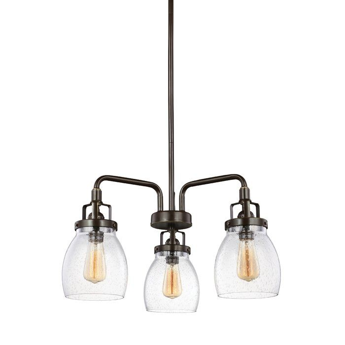 This 3 light single tier chandelier in heirloom bronze provides abundant light to your home, while adding style and interest. Influenced by the vintage industrial designs of early 20th Century America, the transitional lighting collection has seeded glass shades that highlight the classic Edison bulbs. The rich heirloom bronze finish adds another layer of retro design to the warm look. Incandescent medium-base lamping.