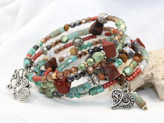This five coil memory wire bracelet is just lovely. A pleasing color combination of light green, orange, brown and gold are accented with metal beads throughout. Different shapes are included as well - square & round seed beads, faceted Czech glass beads, Tigers eye nuggets, Red Jasper
