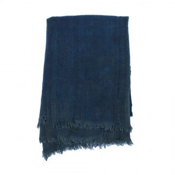 Indigo dyed cotton textile of West African origins. Indigo dye has been used across West Africa for centuries, signifying wealth and beauty for many tribal cultures. These pieces use resist dye techniques like shibori and batik to create unique patterns by hand.