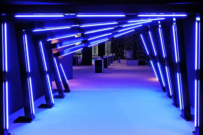 Matching the blue used in the Turner Media Plus graphics, Triton Productions fashioned a brightly illuminated entrance tunnel that led to the reception inside Jazz at Lincoln Center's atrium. The structure placed by the elevator effectively hid other parts of the venue, directing guests to the designated space
