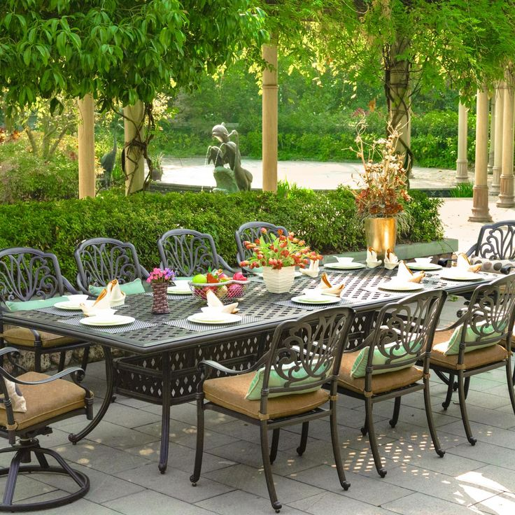 Add elegance to your outdoor dining with this cast aluminum patio set from Darlee. The table accommodates 10 people and includes an umbrella hole for brunch or lunch shading. Visit us to find the right dining set for your outdoor space.