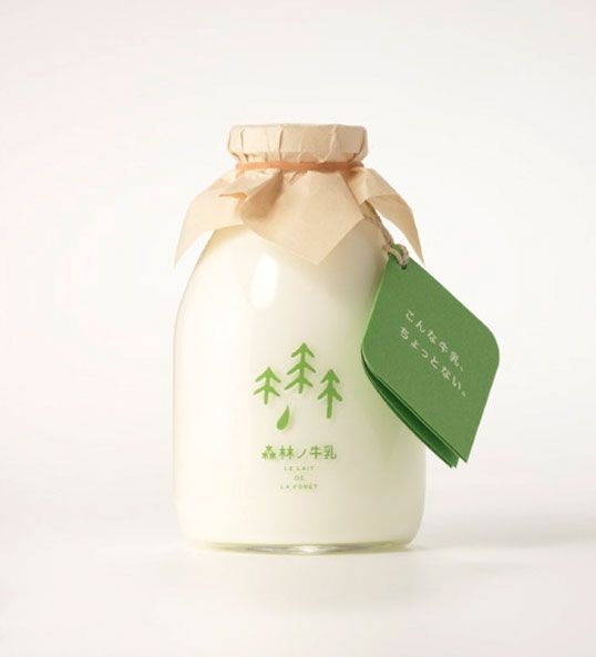 Designed by Rise Design Office The cows which produce this milk are free to roam an unused forest all year round. The milk is supposed to taste better, the theory being that happy cows produce better milk. We like the way the tree graphic reflects the typography as well as the simple yet charming addition of tissue paper covering the bottle cap. Nominated for a Japanese 2009 Good Design Award
