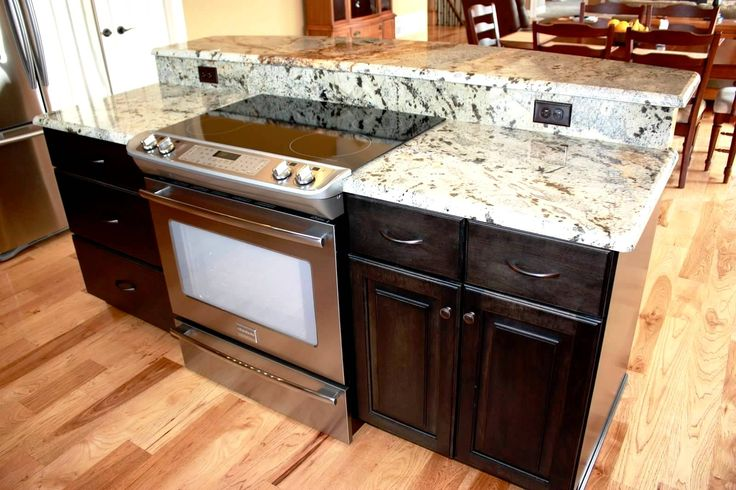 kitchen aid gas stove showroom island with storage, slide in range, and breakfast bar ...