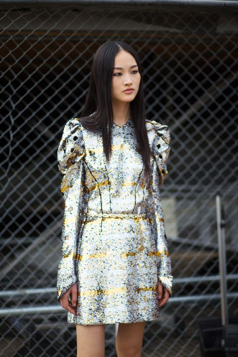 Let these Parisian street style stars inspire your holiday wardrobe: a sequined mini dress.
